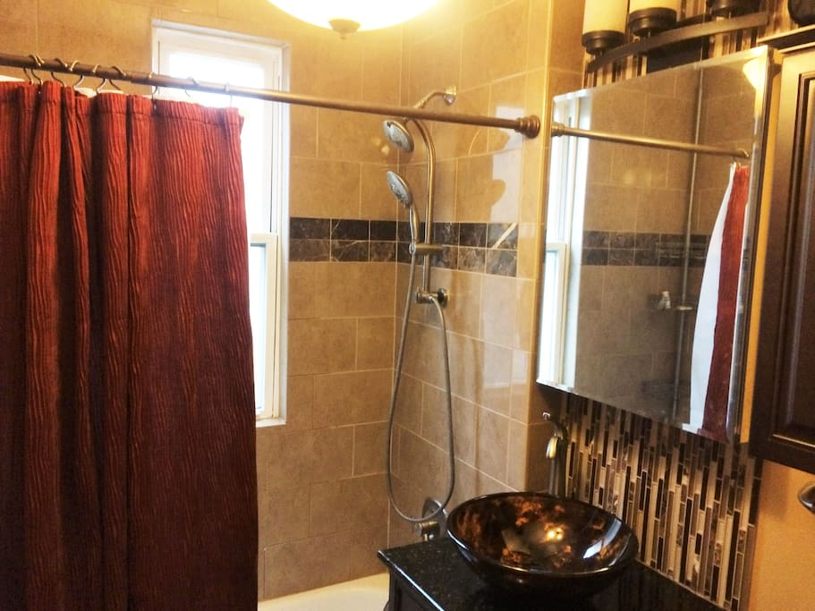 Renovated and updated bathroom with dual shower head