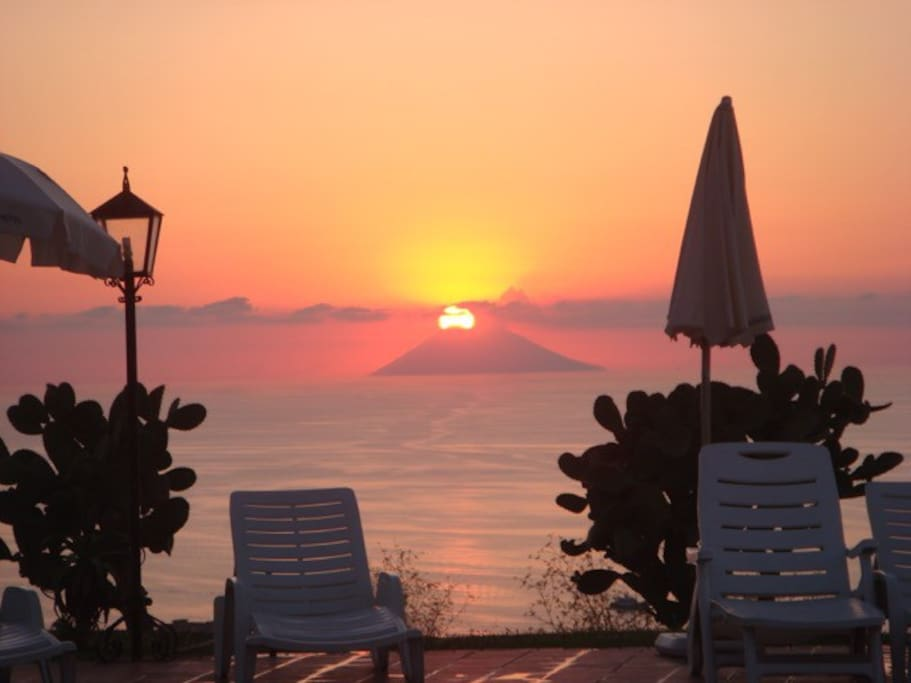The sun sets over the volcano, Stromboli, one of the Aeolian Islands.  There are daily boat cruises from the port of Tropea to the islands.  Tropea is located 3 kilometres from Marasusa.
