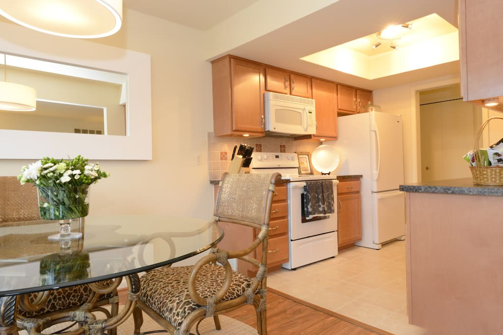 Full Cook's Kitchen with upgrades, including dishwasher, garbage disposal, undercounter lighting, and much more.