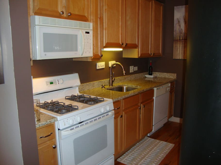 Fully stocked kitchen with ice maker, garbage disposal, dish washer, microwave. Granite counter tops.