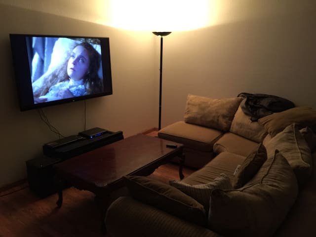 """Living room with 60"""" flat screen TV"""