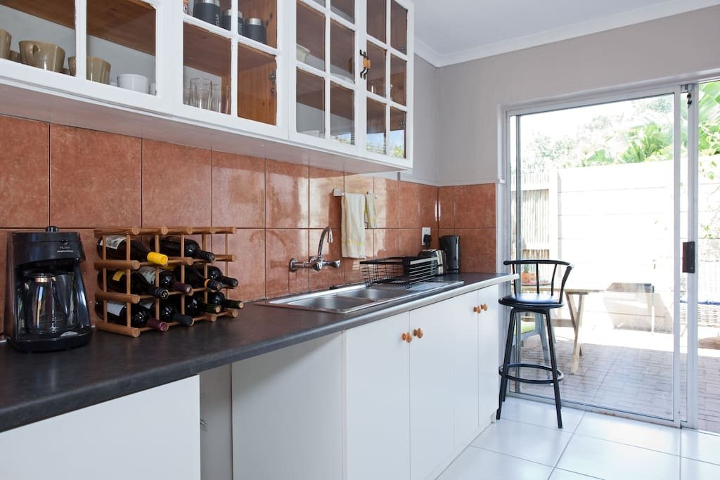 Fully equipped kitchen, pictured is the coffee machine, toaster, kettle, wine rack and crockery cupboards.