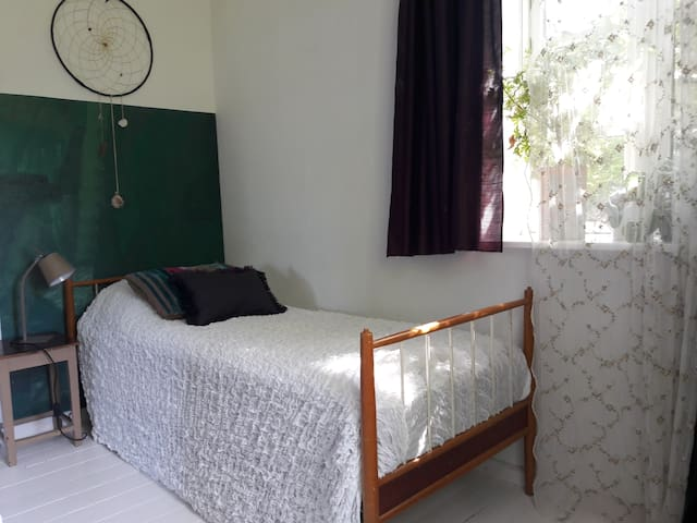 your bed. the room is very bright and has a lot of green plants.  it has light blinds so you will have privacy and blackout curtains, if you wish to sleep completely in the dark.