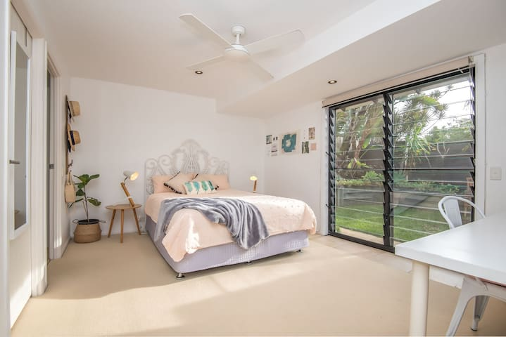 Downstairs queen bedroom with walk-in robe and ensuite