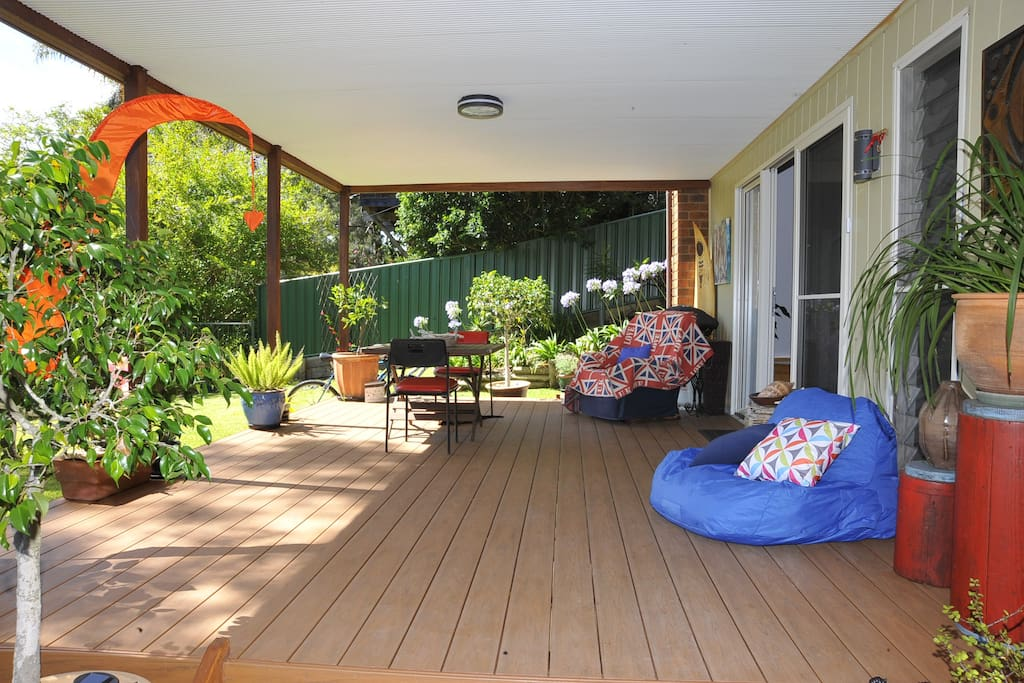 Outdoor deck with table, chairs and lounging chairs