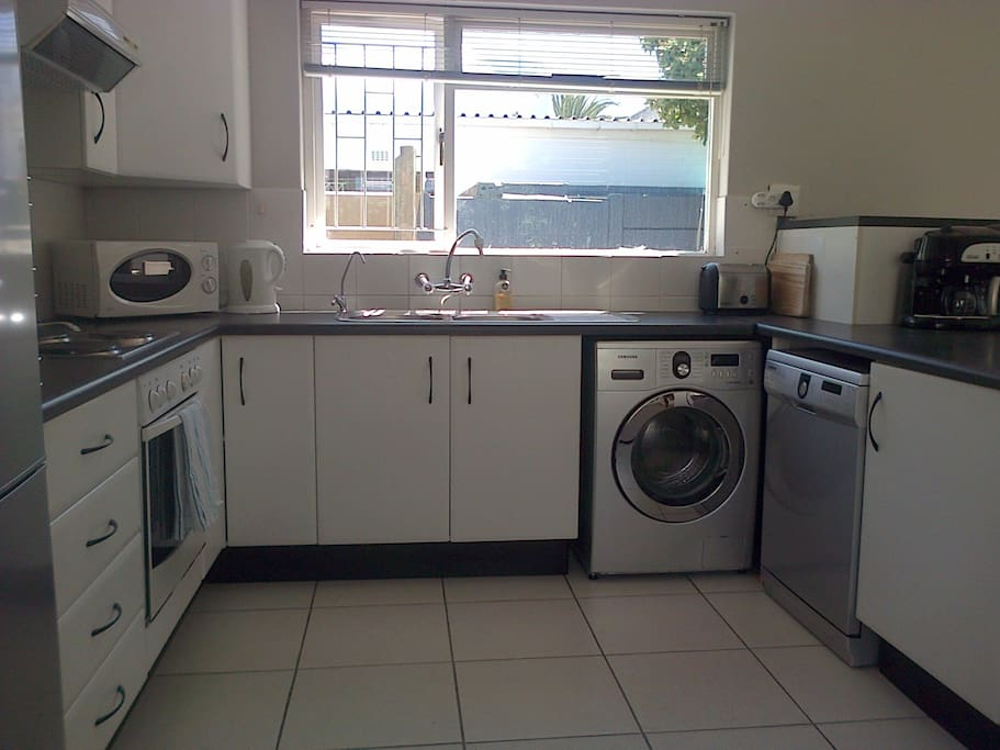Kitchen with view of the mountain. Dishwasher and washing machine