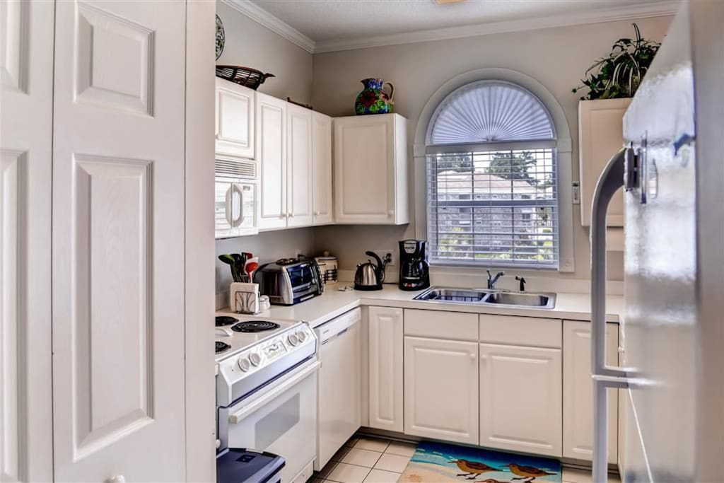 Kitchen is equipped with all necessary appliances.