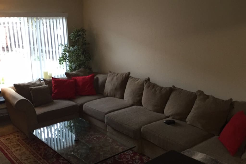 Full couch, seats 10 comfortably. Beautiful 2 piece glass table