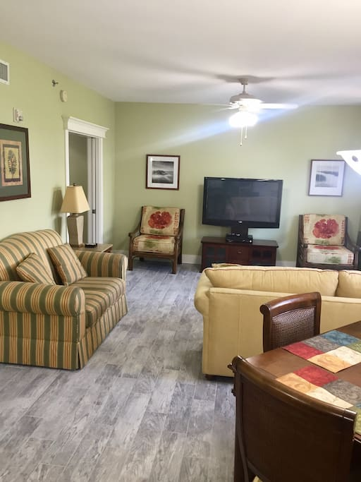 Living room with queen sleeper sofa and 50' flat screen TV