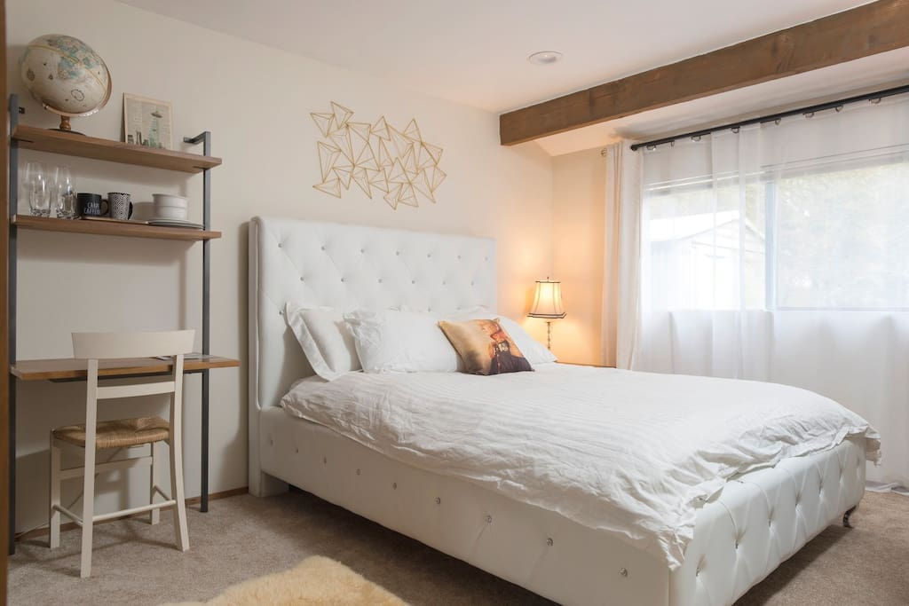 Your bedroom - queen bed, desk, mini fridge, Keurig coffee machine, microwave, cutlery, bowls, plates, luggage rack and soft guest bathrobes