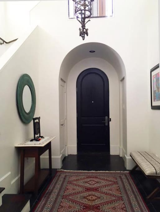Gorgeous, clean and bright shared Foyer with antique lighting and banisters