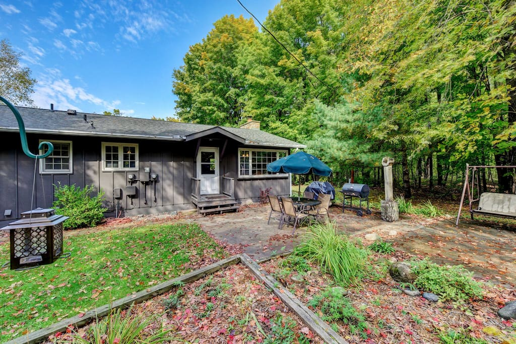 With a patio, fire pit and woodland setting, this is an outdoor lover's dream.