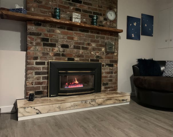 Who doesn't like to snuggle up to the warmth and glow of a fireplace, especially one that you don't need to add wood to. We recommend a cozy evening curled up in front of the gas insert fireplace.