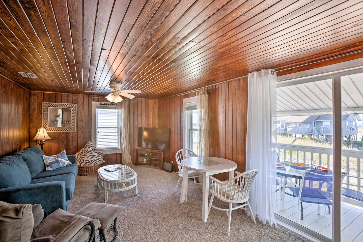 Make this cozy, old school duplex your home-away-from-home by the beach.