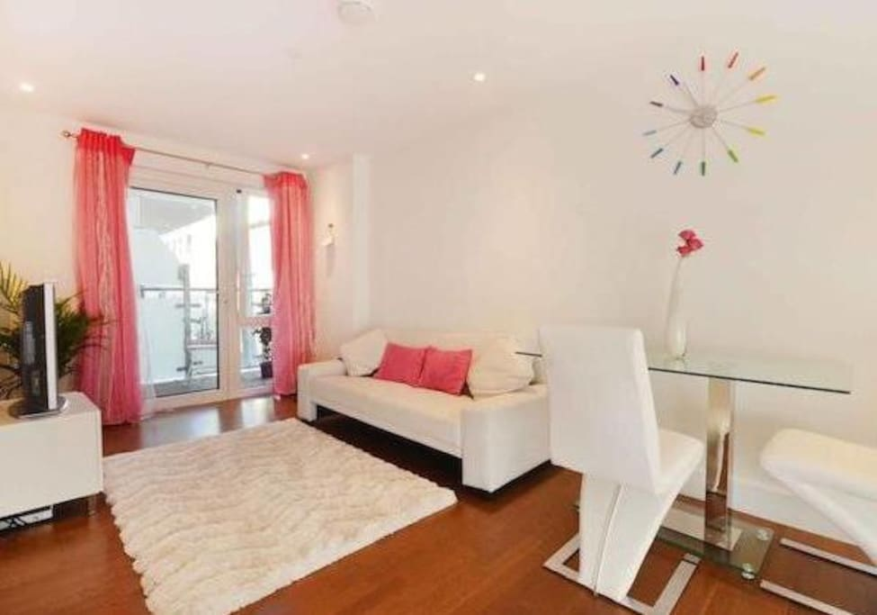 Spacious open-plan kitchen/living-room. Wood-heated flooring. Opens out to balcony...