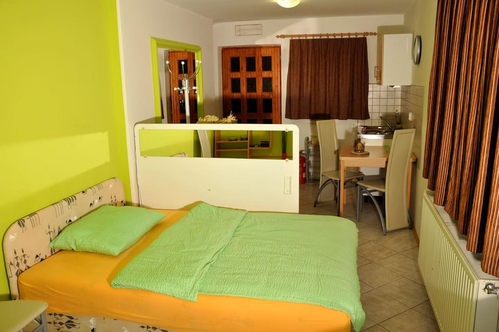 Double bed and  small kitchen with basic equipment.