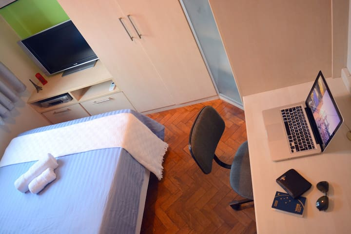 Desk with space for your laptop and a chair to work in.