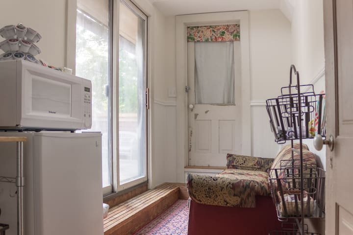 Solarium has a Keurig, mini fridge, and microwave along with flatware, set of dishes, wine glasses and other extras.