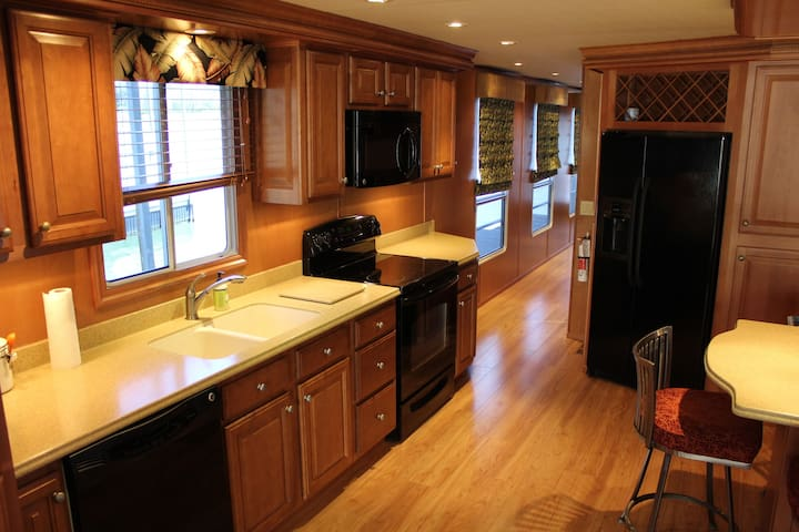 The Galley with Full Size Dishwasher, Range, Oven, Microwave, Refrigerator & Freezer.