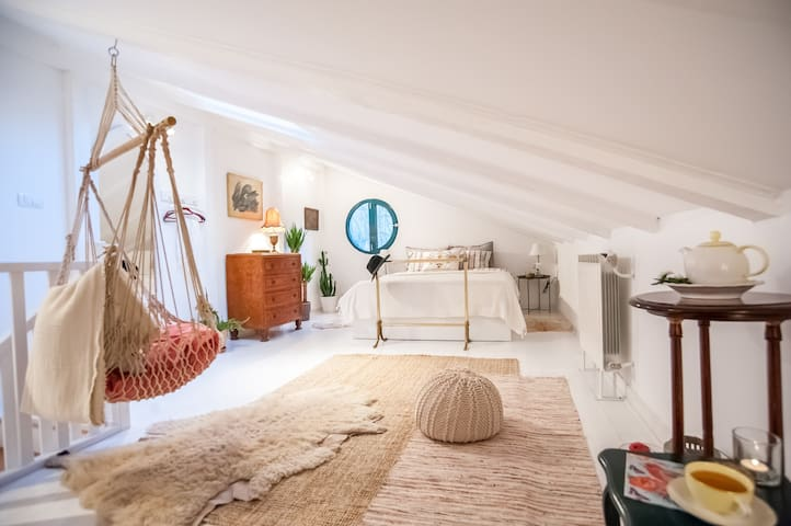 Loft bedroom full of light during the day