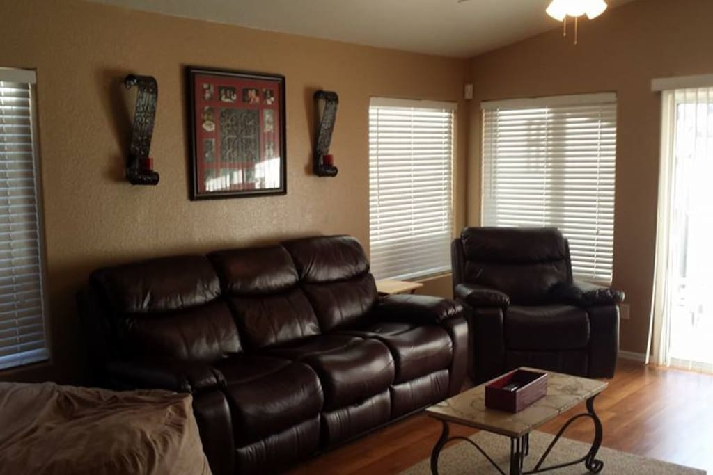 Comfy leather sofa with dual recliners, additional recliner & 2 person bean bag chair!