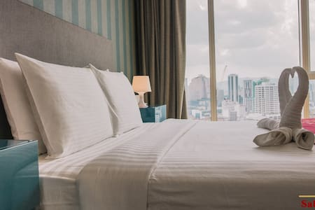 Bed / City View