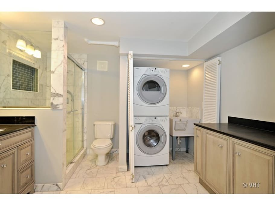 Marble bathroom with washer and dryer