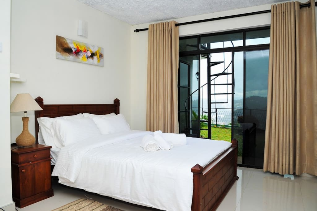 Room with view facing the kandy city and surrounding hills.