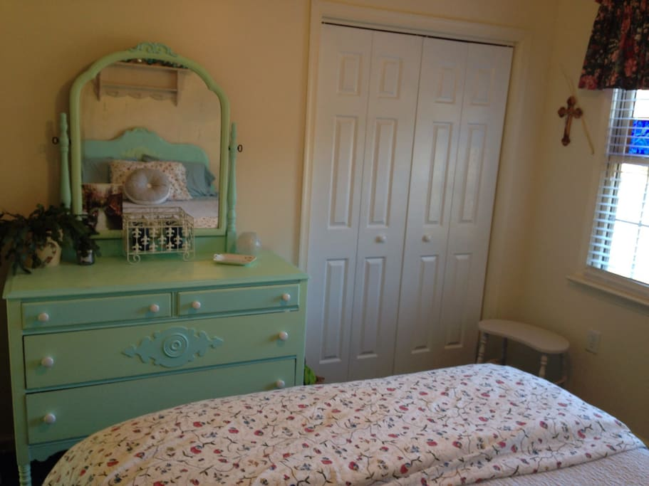 Closet for hanging wardrobe. Queen size bed