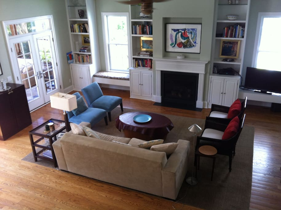 Sunny open living room with french doors to screened porch