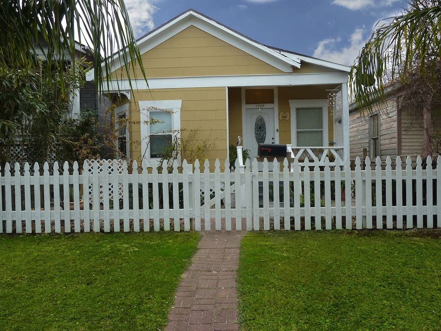 Front of the house with a newly built picket fence.