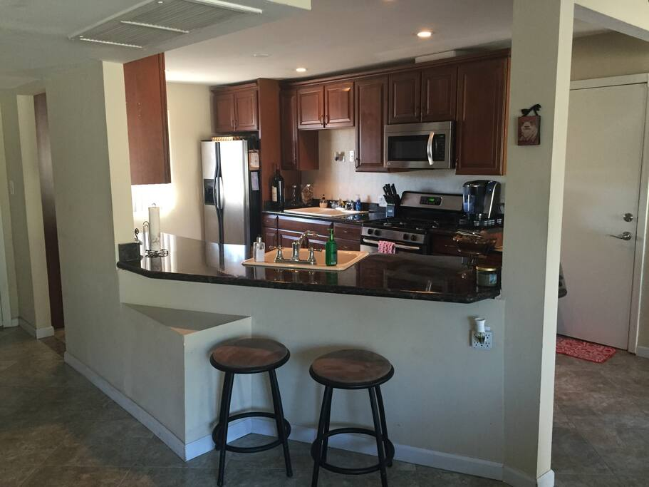 Open Kitchen with two sinks, granite counters, and all your cookware and dishware needs.