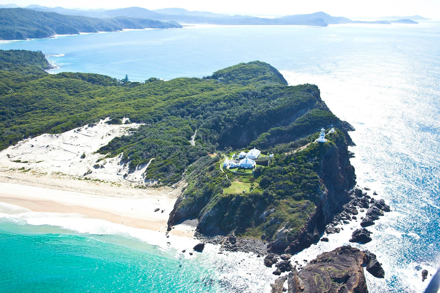 Sugarloaf Point Lighthouse, Seal Rocks NSW. 3 lighthouse keepers' cottages nestled beneath lighttower