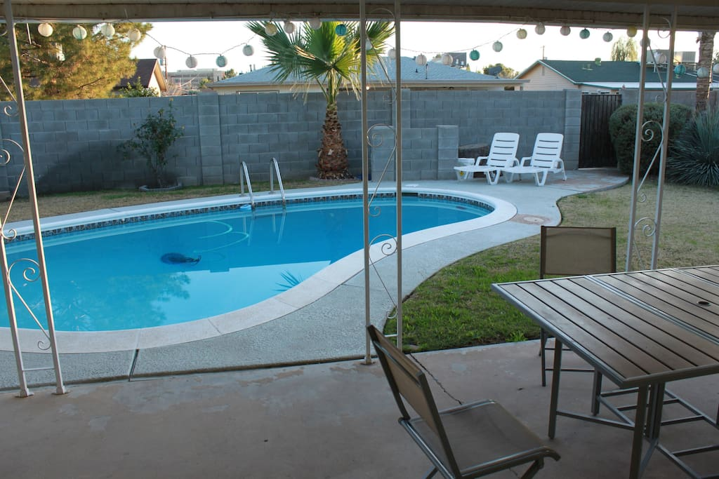 Pool and enclosed yard with a grill