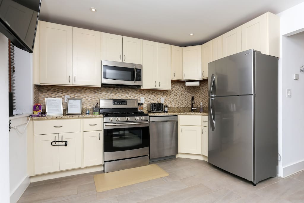 Full Gourmet Kitchen, Gas Range, Microwave, Dishwasher, and Refrigerator.