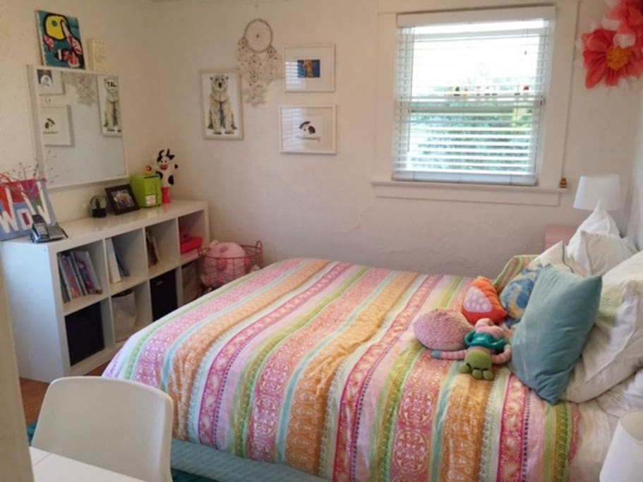 Queen Sized bedroom with closet and a door to the side yard as well.