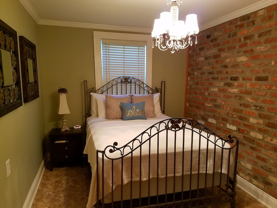 Bedroom features Queen size bed, chest of drawers, nightstand, luggage stand, TV with ROKU, Netflix, Hulu, local channels.