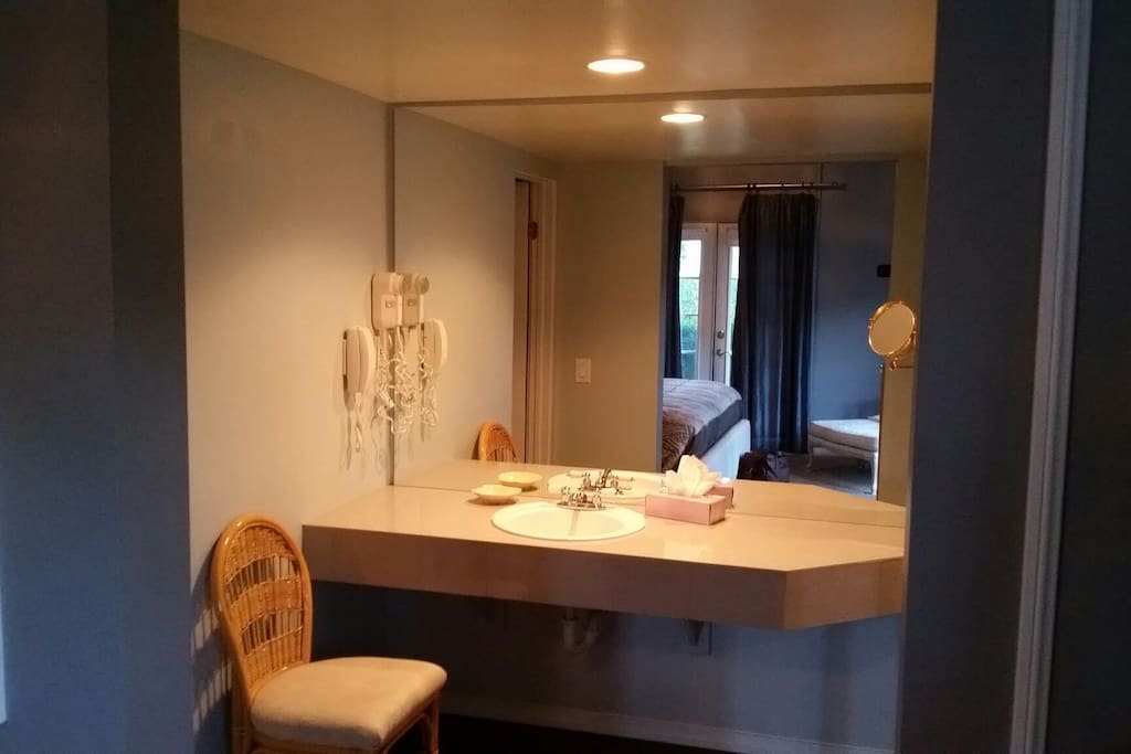Vanity area with separate sink and built in blow dryer