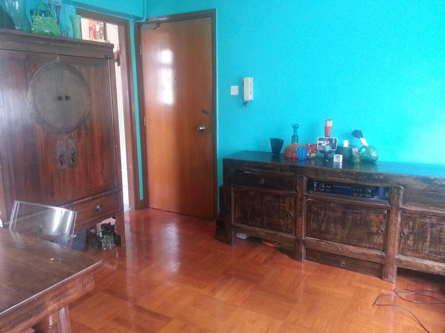Bright living room in aqua with parquet floors.