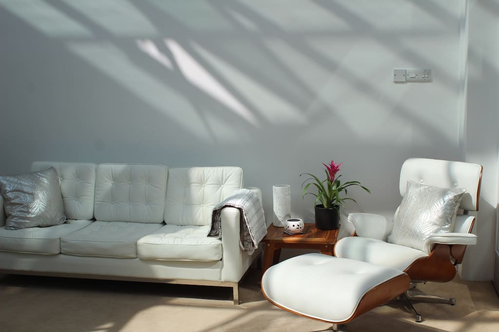 Lounge area with spiral staircase leading to bedroom and ensuite