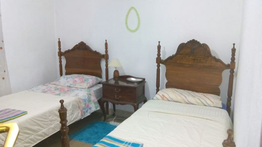 2 single beds,1 or 2 guest, wifi, key, main street