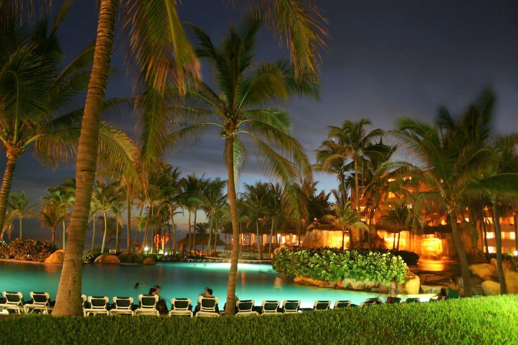The resort pool after nightfall.