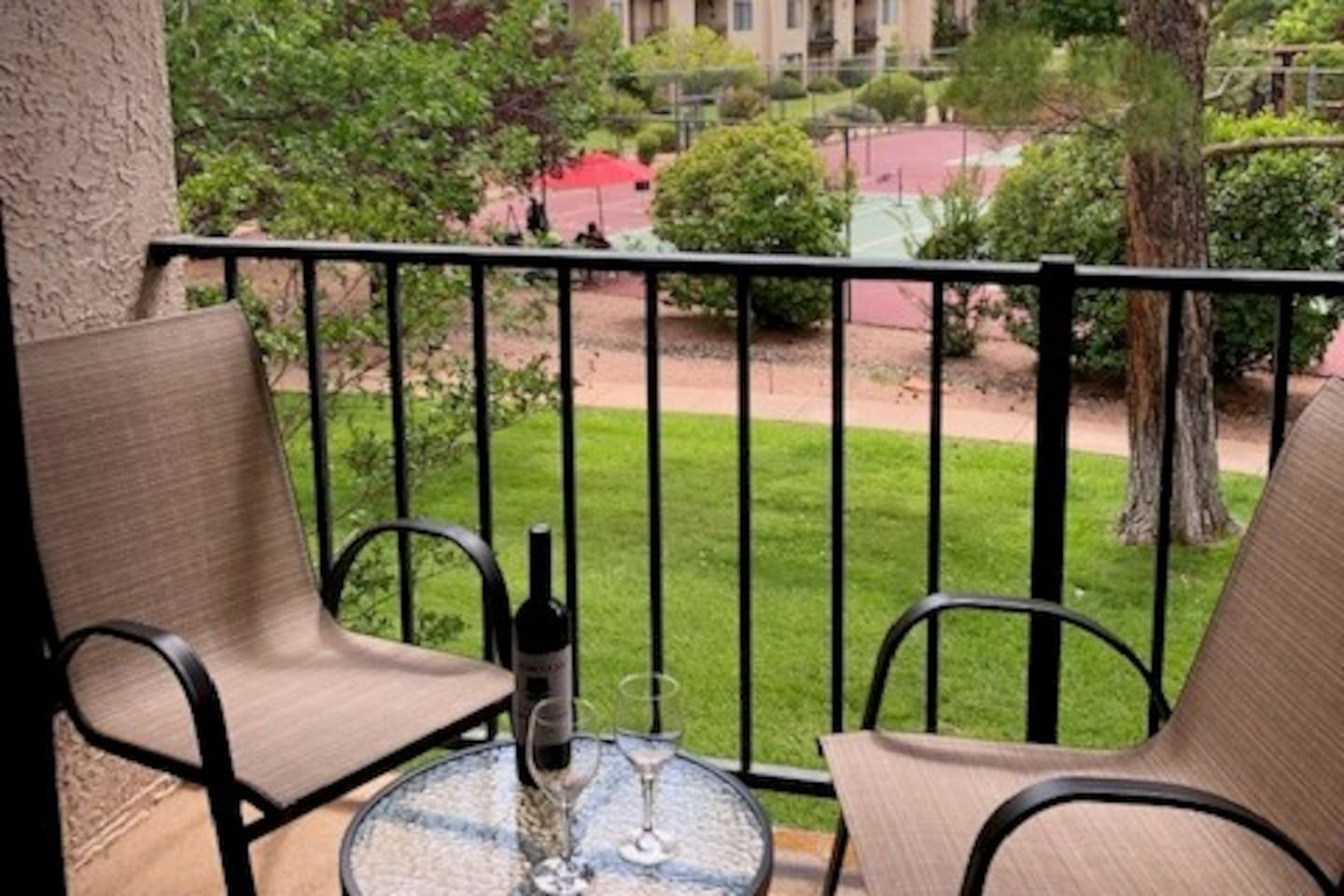 Enjoy a glass of wine and relax on the balcony