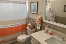 Full bathroom with linens included