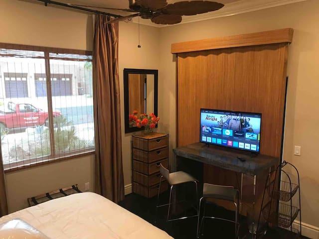 Hightop Desk area with Netflix only TV... TV room is available to guests if access to cable TV necessary. OR simply  book our Green Room also listed. See additional drawer storage to left of desk...