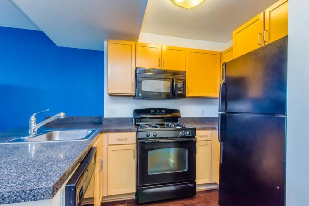 Full kitchen with gas stove, refrigerator, microwave.
