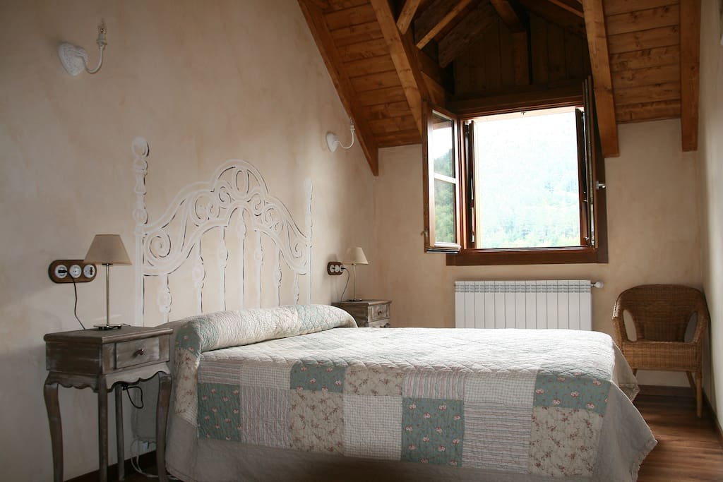 Large double bedrooms artistically decorated.