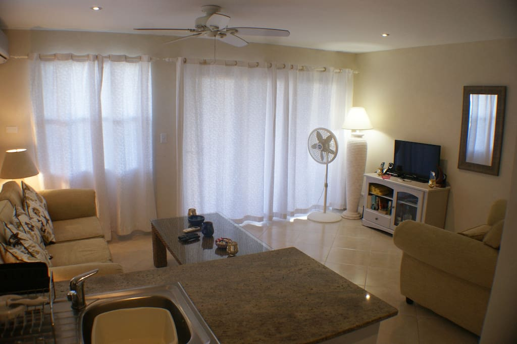 Spacious living area with doors leading to balcony
