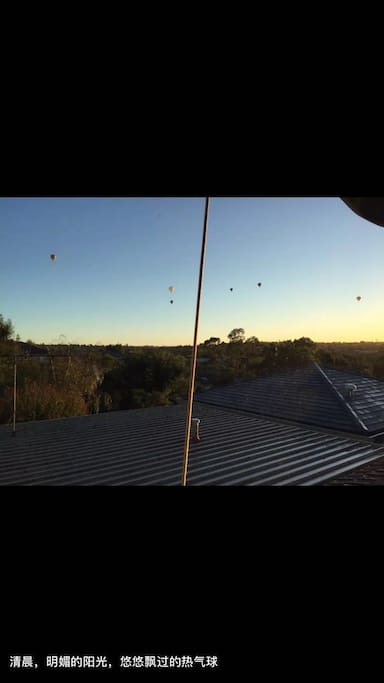 View from the room window---hot air balloon in the early morning