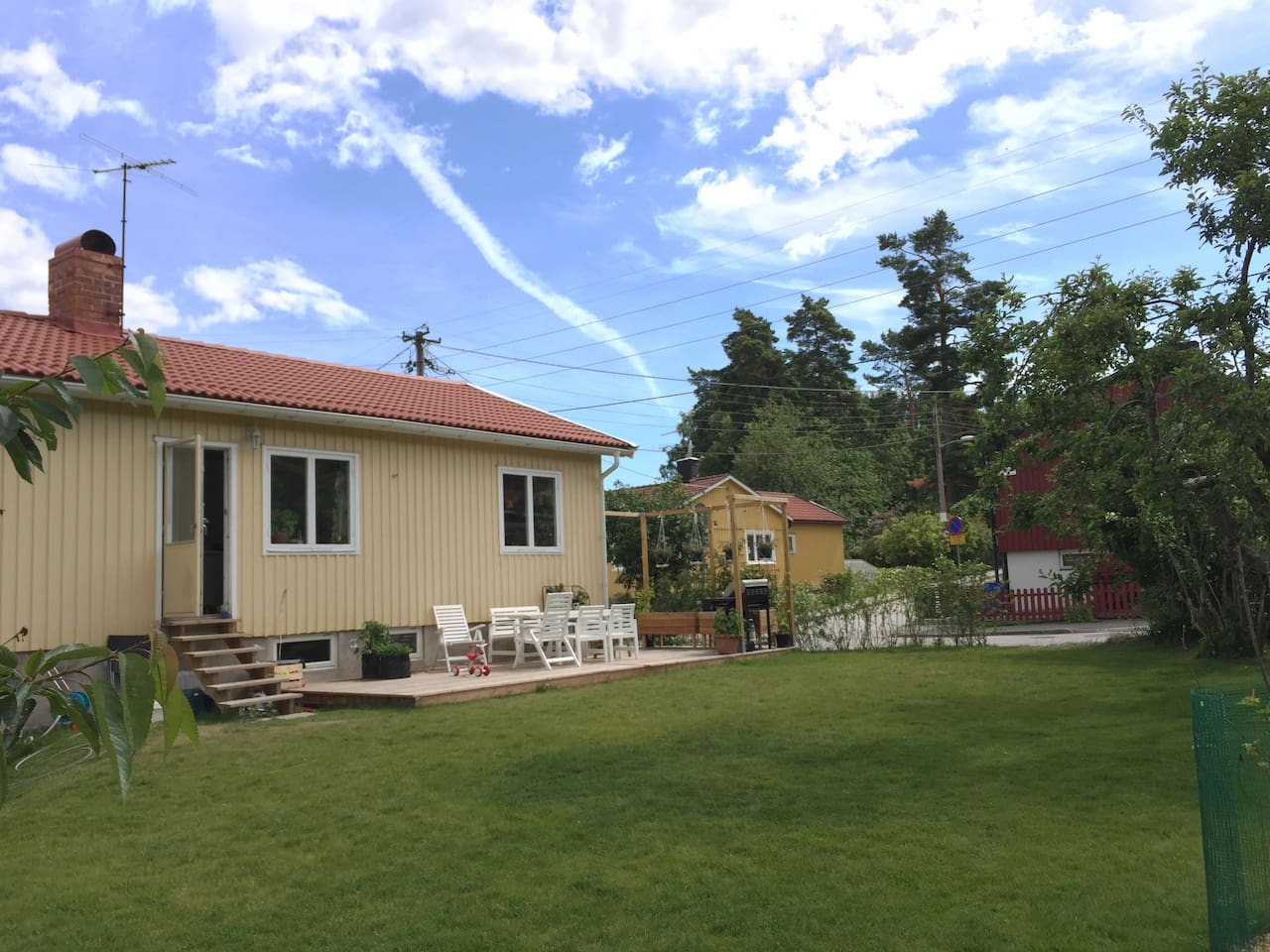 Pleasant garden with wooden deck, barbecue and seating for up to 10 people